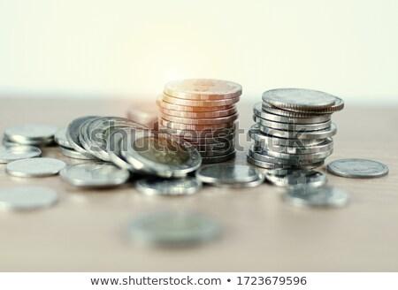 Group of Thai baht coins on white table background Stock photo © nalinratphi