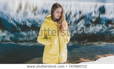 女性 黄色 コート 山 谷 かわいい ストックフォト © dash