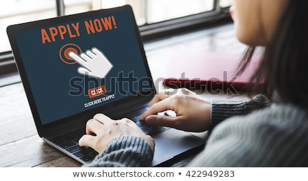 apply now concept on laptop screen stock photo © tashatuvango