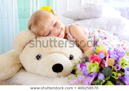 Blonde lady with big white flower. Stock photo © NeonShot