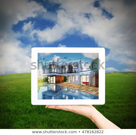 3D Rendering Architect showing new house project with tablet Stock photo © alphaspirit