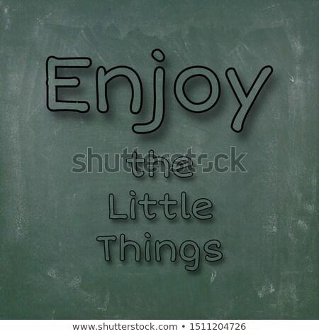 Enjoy little things text on green board Stock photo © fuzzbones0