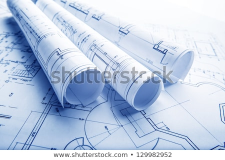 Architectural project, blueprints, blueprint rolls on plans. Stock photo © klss