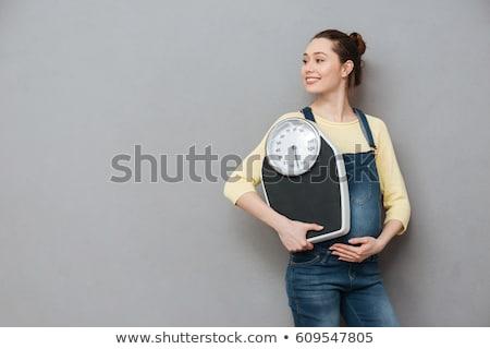 embarazadas · escalas · mujer · embarazada · pie · aislado · blanco - foto stock © dolgachov