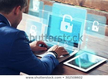 Young hacker in digital security concept Stock photo © Elnur