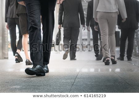 businessman legs walking go forward as outstanding by other legs Stock photo © FrameAngel