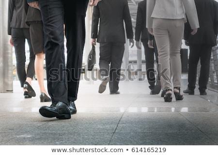 businessman legs walking go forward as outstanding by other legs stock photo © frameangel