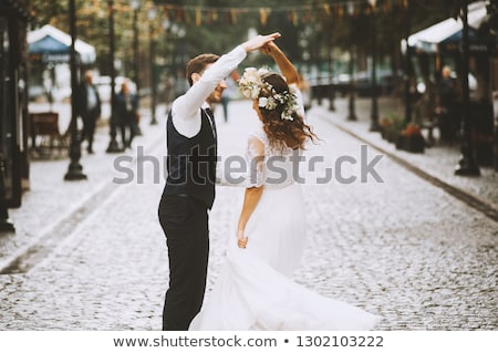 bride and groom posing on the streets Stock photo © tekso
