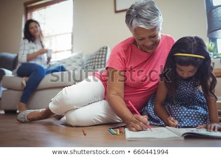Babcia wnuczka kolorowanka życia salon domu Zdjęcia stock © wavebreak_media