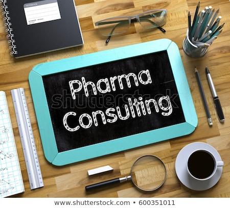 pharma consulting   text on small chalkboard 3d stock photo © tashatuvango