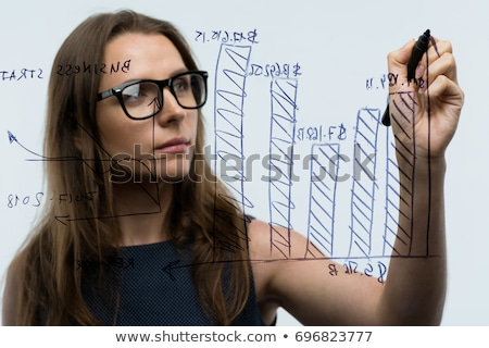 Woman draws various growth charts, calculating prospects for suc Stock photo © vlad_star