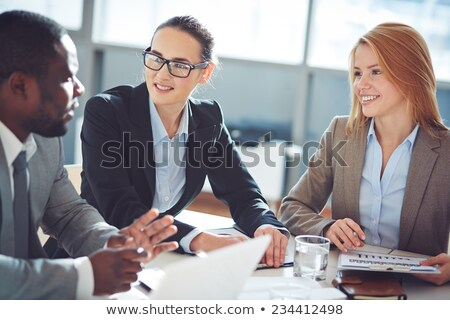 2 businesswomen interviewing man Stock photo © IS2