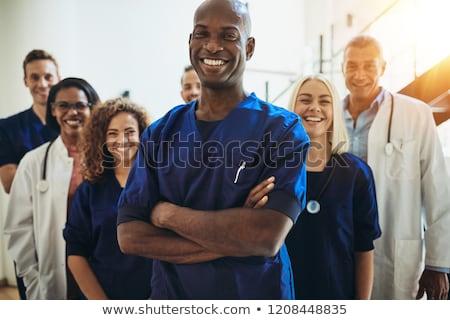 портрет · мужской · доктор · Постоянный · коридор · больницу · человека - Сток-фото © is2