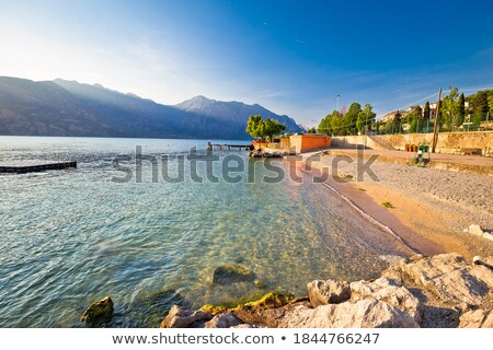 Beach im Malcesine on Lago di Garda Stock photo © xbrchx