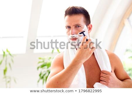 Сток-фото: выстрел · красивый · мужчина · улыбаясь · лице · электрических