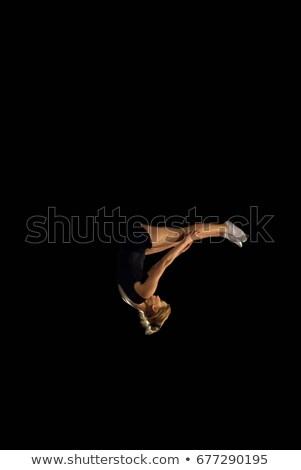 Vrouwelijke gymnast ondersteboven vlucht sport fitness Stockfoto © IS2