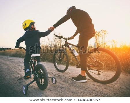 Boy biking in field of flowers Stock photo © IS2