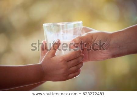 Lány üveg tej gyermek mosolyog aranyos Stock fotó © IS2
