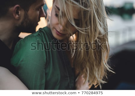 portrait of a young cheerful couple embracing outdoors stock photo © konradbak