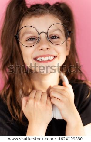 Portré fiatal lány fülhallgató hátizsák ül lábak keresztbe Stock fotó © deandrobot
