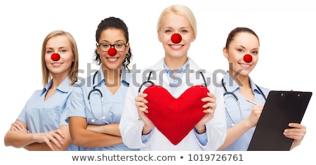 group of smiling doctors at red nose day Stock photo © dolgachov