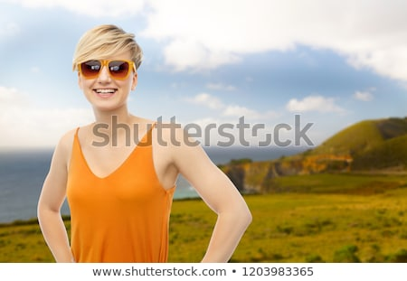 teenage girls or young women over big sur coast Stock photo © dolgachov
