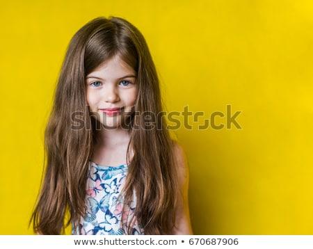Kicsi gyönyörű lány ül feketefehér szék mosolyog Stock fotó © acidgrey