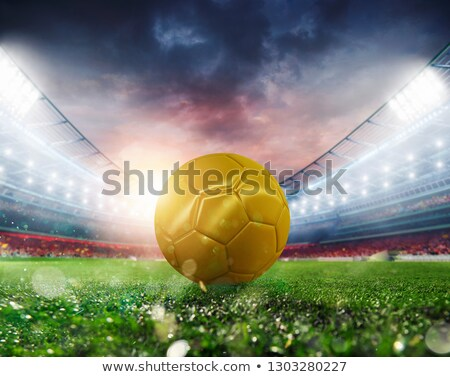 Foto stock: Golden Soccerball At The Stadium Ready For Match