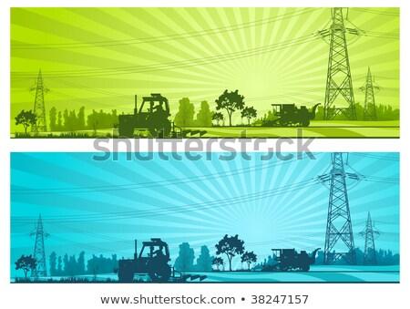Trator campo alta tensão linhas terra trabalhando Foto stock © simazoran