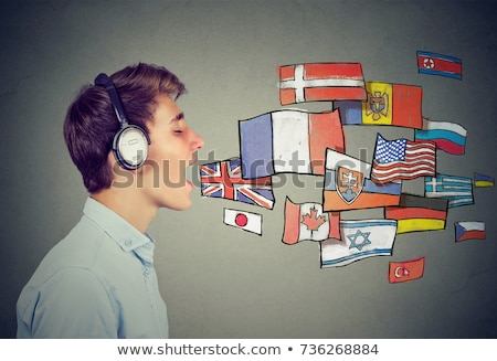 Young man in headphones learning different languages Stock photo © ichiosea