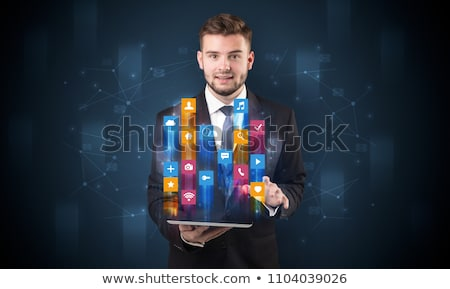 Man holding tablet with hologram app icons above Stock photo © ra2studio