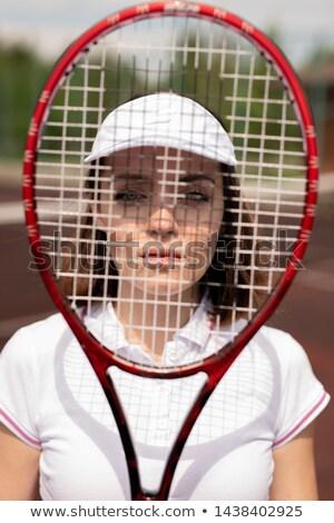Csinos fiatal komoly teniszező mögött ütő Stock fotó © pressmaster