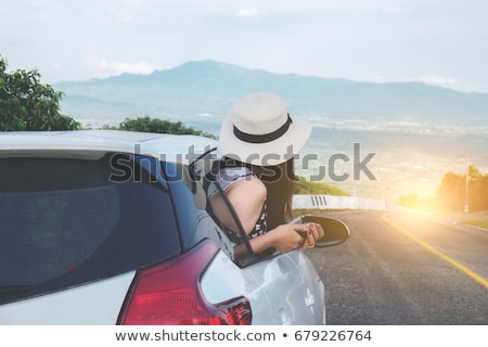 Relaxed happy traveler, Young beatiful asian gilr using smart ph Stock photo © Freedomz