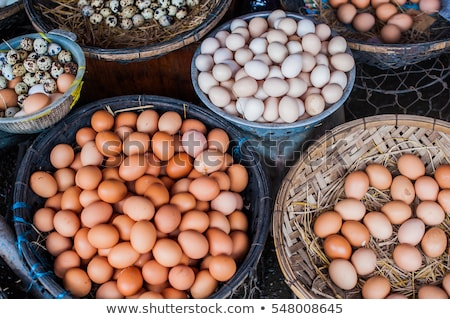 The eggs - chicken and quail in the wicker basket on the Vietnamese market. Asian food concept Stock photo © galitskaya