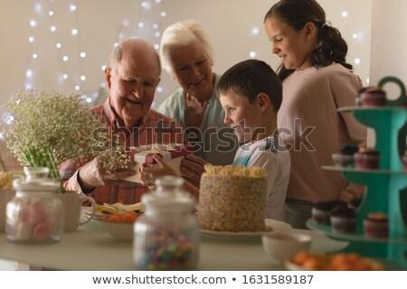 Aile sunmak doğum günü erkek ev oturma Stok fotoğraf © wavebreak_media