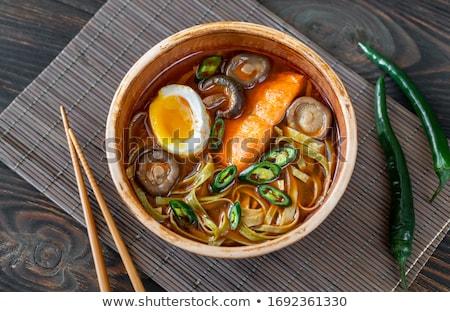 Ramen egg noodle soup dish with salmon fish Stock photo © joannawnuk