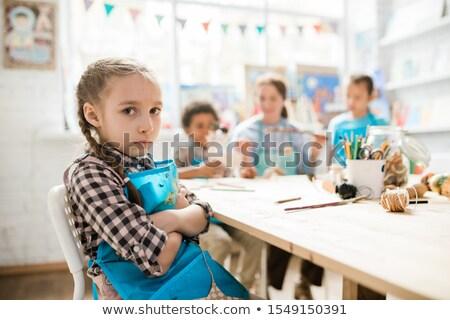 Cute одиноко девушки фартук сидят Одноклассники Сток-фото © pressmaster
