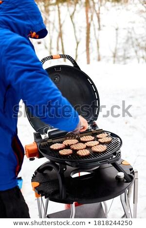 Férfi grillezés hordozható BBQ tél barbecue Stock fotó © Illia