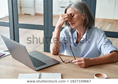 Senior mulher secar olho síndrome gotas Foto stock © dolgachov