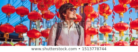 Man celebrate Chinese New Year look at Chinese red lanterns. Chinese lanterns BANNER, LONG FORMAT Stock photo © galitskaya