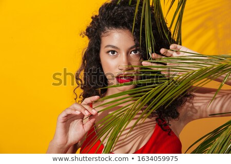 Concentrated woman in swimwear near green plant. Stock photo © deandrobot