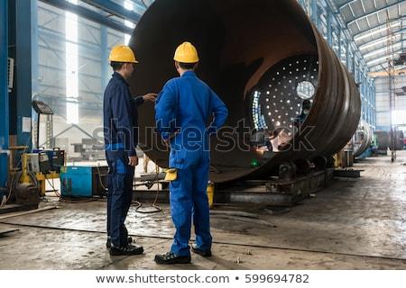 Zwei Arbeitnehmer Schweißen Fabrik Herstellung Innenraum Stock foto © Kzenon
