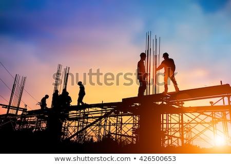 строительство · работу · работник · конкретные · лопатой · человека - Сток-фото © poco_bw