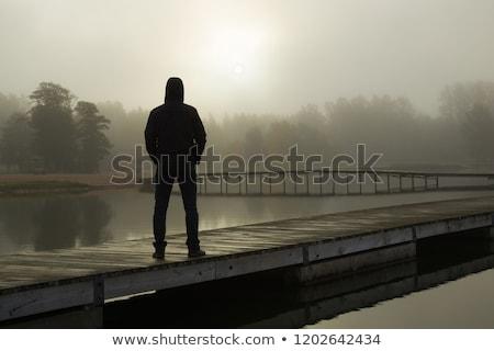 задумчивый молодым человеком пешеходный мост человека стены моста Сток-фото © Paha_L