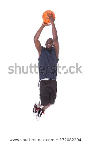 Сток-фото: Young Man Jumping Studio Shot Over White