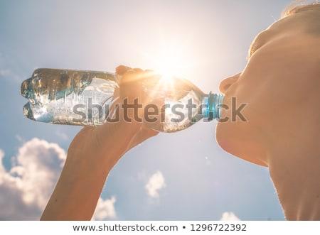 genç · heyecanla · şişe · su · güzel - stok fotoğraf © zastavkin