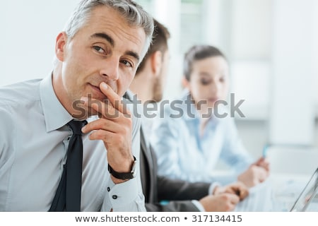 Executive with chin in hand Stock photo © photography33