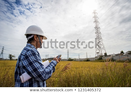 électricien téléphone portable construction fond costume Photo stock © photography33