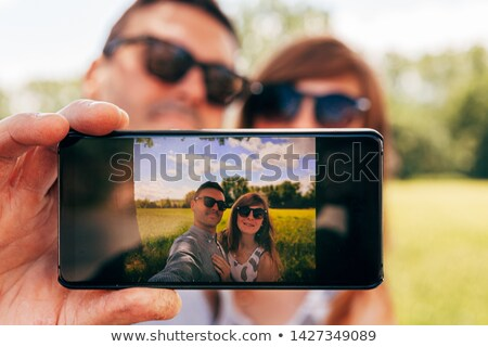 Couple in countryside taking photos Stock photo © photography33