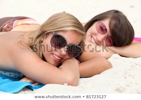 Couple laying on beach towel Stock photo © photography33